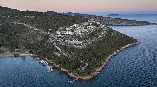 5 yıldızlı tatil köyü ile 2 yurt satın alıyor